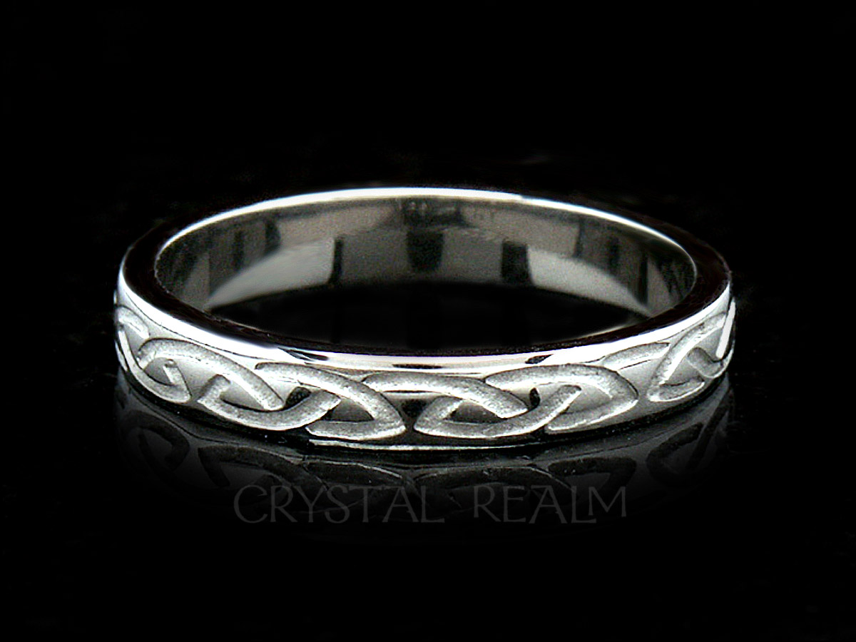 Irish Celtic wedding band with a recessed eternal knot design