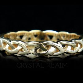 Celtic wedding ring in open eternity knot style and 14k yellow gold