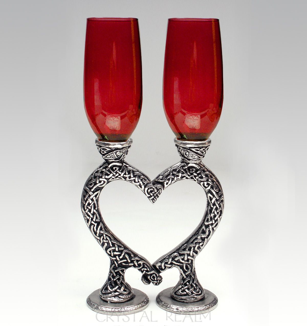 red toasting glasses with celtic heart stems