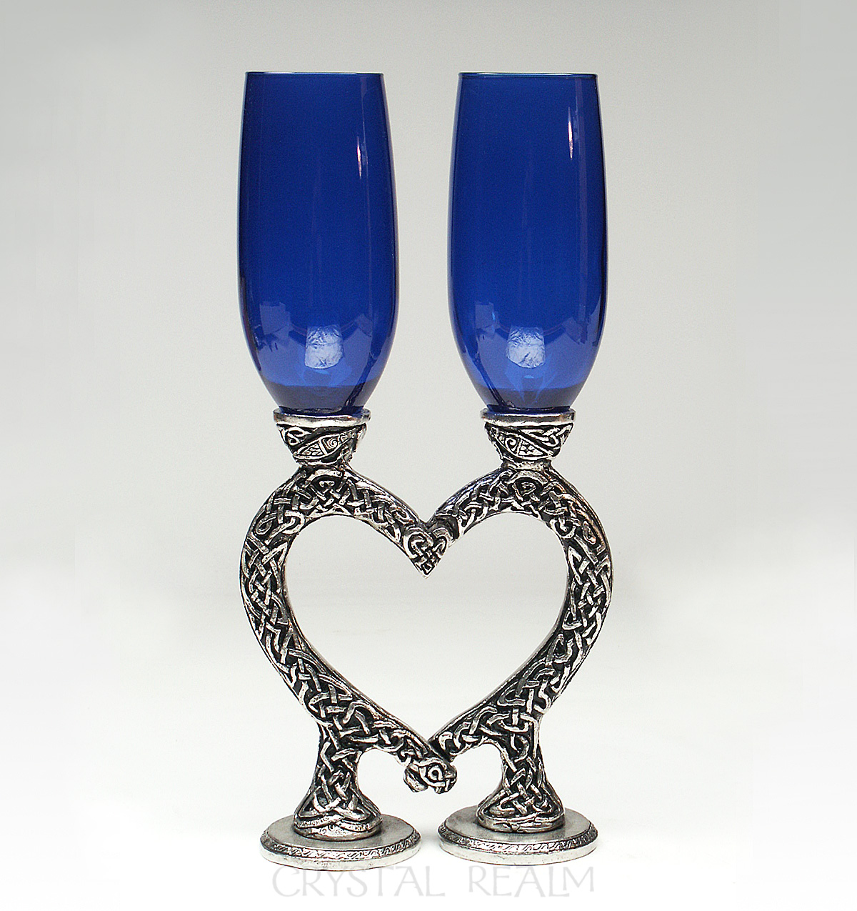 Royal blue toasting flutes with Celtic heart stems