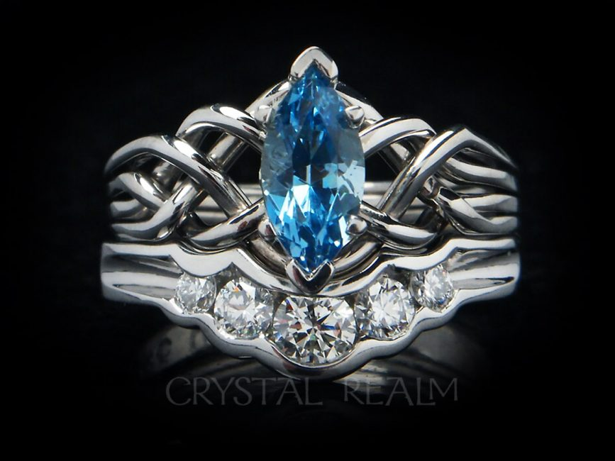 Four band puzzle ring with marquise aquamarine paired with a 5-diamond shadow band