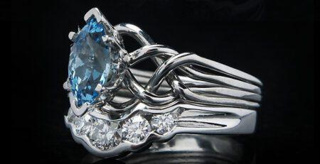 Celtic marquise aquamarine puzzle engagement ring with diamond shadow band