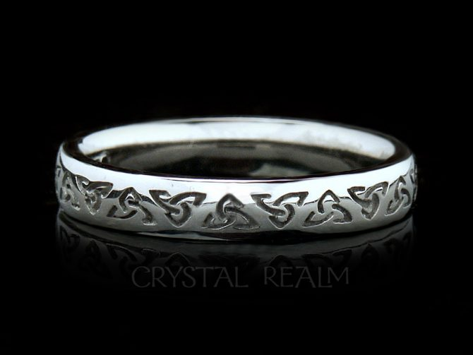 Irish Celtic wedding band with recessed trinity knots in palladium or white gold