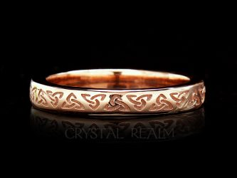 Irish Celtic wedding ring with trinity knots and 14k rose gold