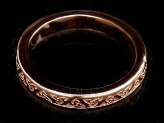 Rose gold Irish Celtic wedding band with inscribed trinity knots