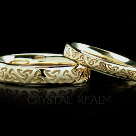 Irish Celtic wedding band with inscribed trinity knots in 14k yellow gold