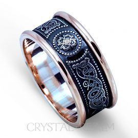 oxidized celtic warrior ring with raised sterling silver center design and 10k yellow gold heavy rims