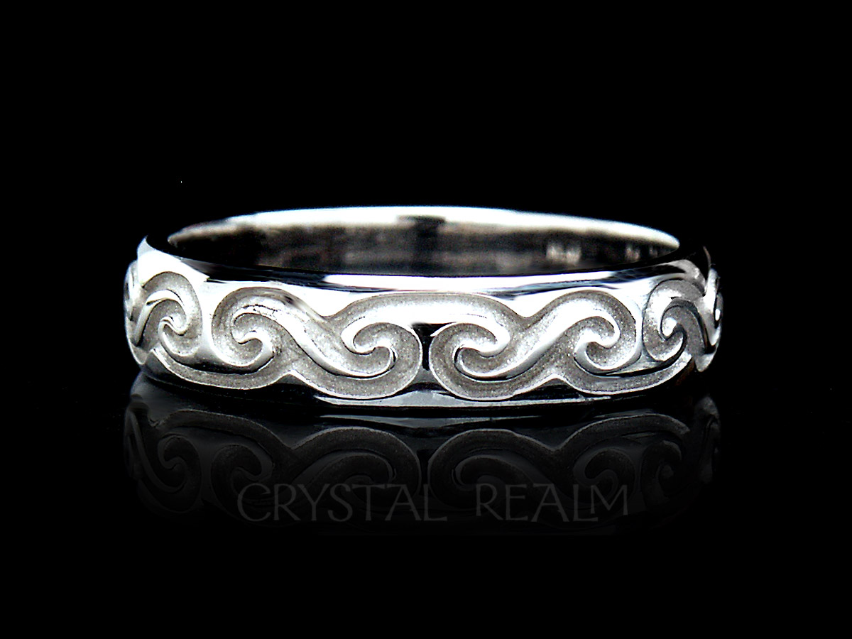 Handmade mens celtic wedding band with spiral wave knots