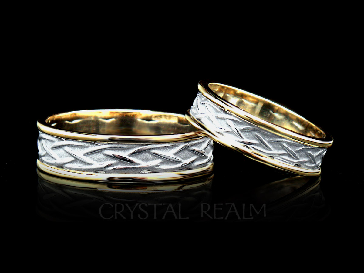 celtic wedding band with center weave knots in 14k white gold trimmed with 14k yellow gold