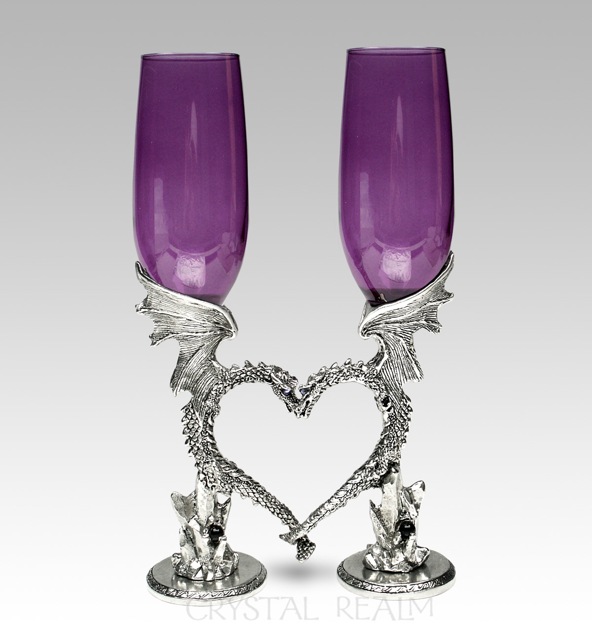 Purple toasting glasses with dragon heart stems