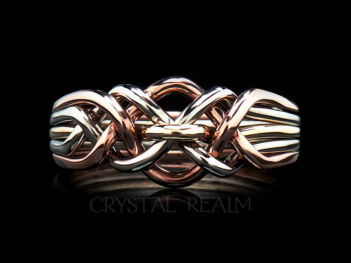Five band loop puzzle ring in 14k white, yellow, and rose gold and heavy weight