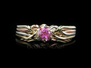 Four band puzzle ring with round pink tourmaline shown with four colors of 14K gold