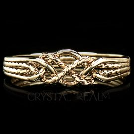 four band puzzle ring with twisted x 14k yg 1