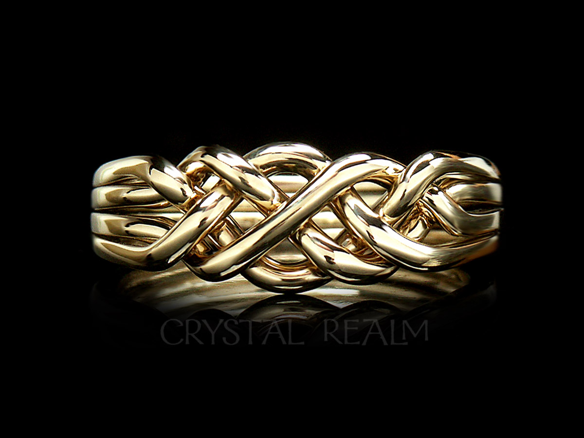 4 piece puzzle ring in medium heavy weight and 14k yellow gold