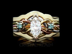 bridal set with 3/4CT marquise diamond and two blue-green accent diamonds in four colors of 14k gold and a 14k yellow gold shadow ring guard