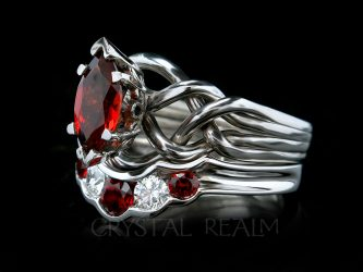 Four band puzzle ring with one carat marquise garnet and garnet-diamond wedding band