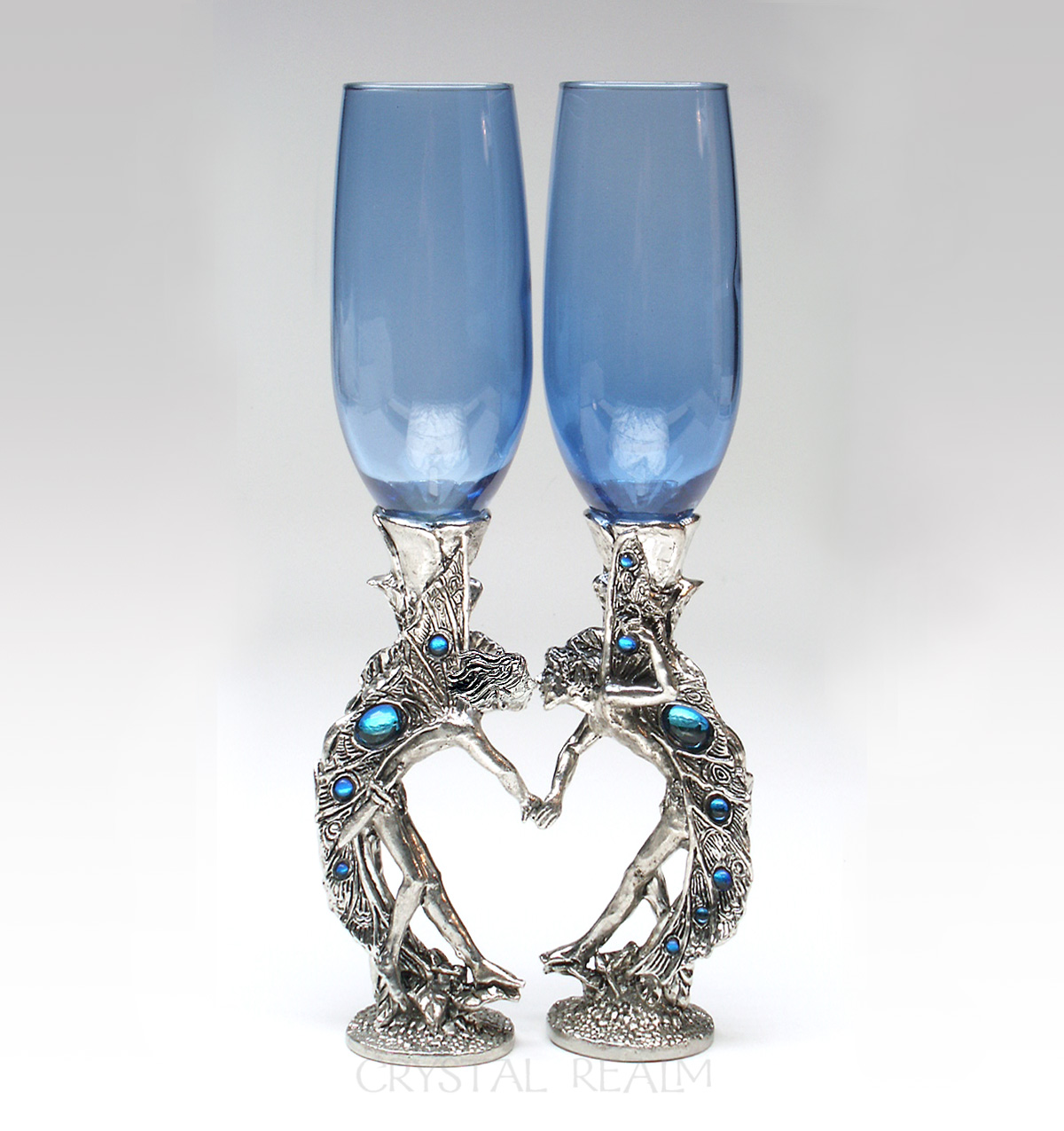 Blue champagne glasses with fairies in a heart shape