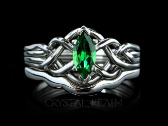 4 piece puzzle ring with one half carat tsavorite green garnet and custom fit shadow band