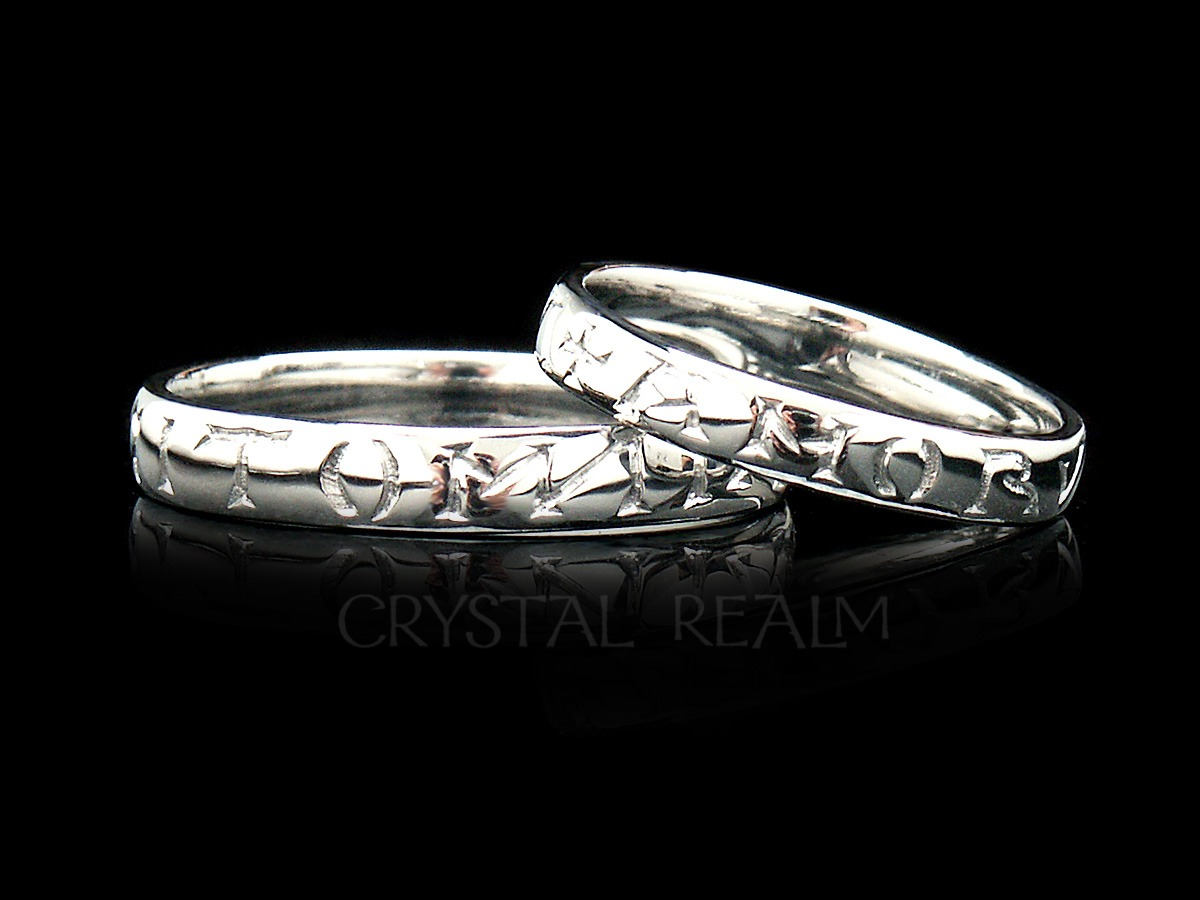 Platinum poesy ring with love conquers all, or amor vincit omnia inscribed in the Latin