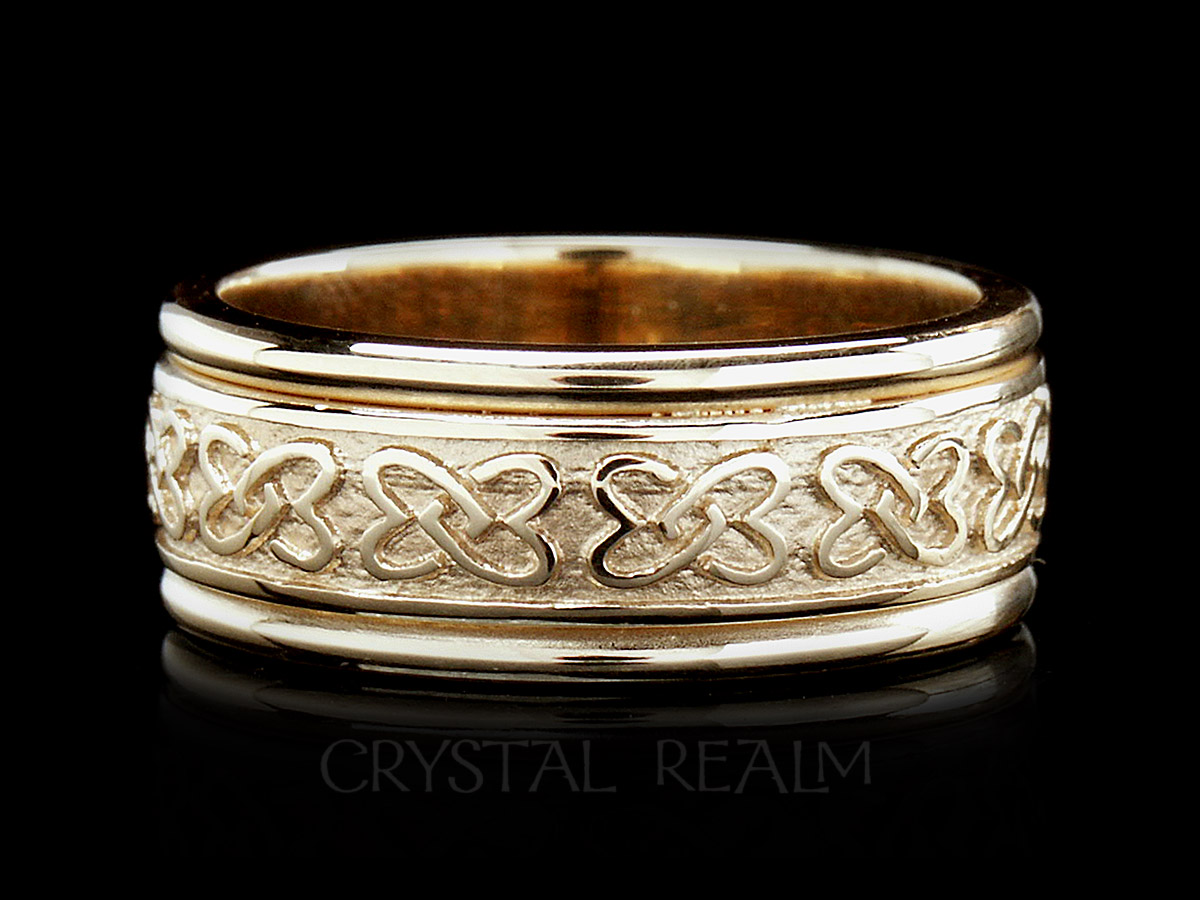 Handmade irish celtic wedding ring with double love knots and trim all in 14k yellow gold