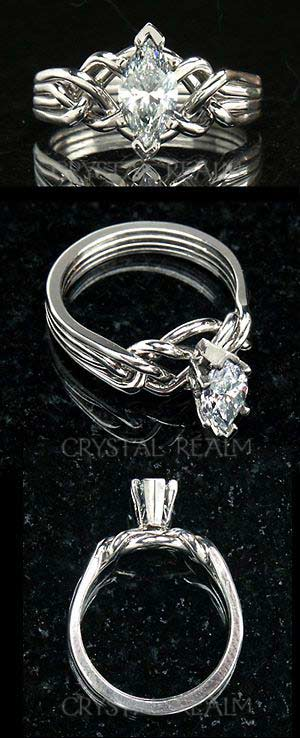 Four band puzzle ring with 0.72ct marquise diamond