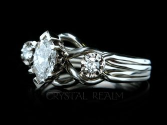 a marquise-diamond, three stone palladium puzzle engagement ring
