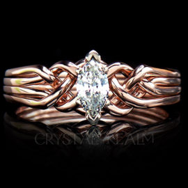 Marquise four piece puzzle ring with one third carat diamond and standard weave in 14k rose gold