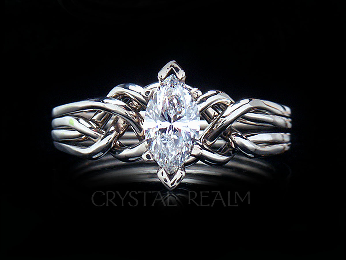 Palladium 4 piece puzzle ring with marquise diamond and standard weave