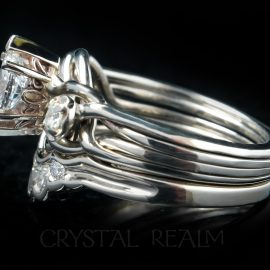 A bridal set based on a three-diamond engagement puzzle ring with an open weave and a graduated five-diamond shadow band