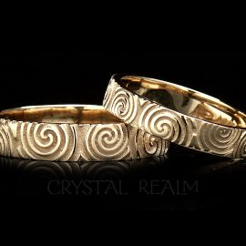 irish wedding rings in 14k yellow gold with celtic spiral design
