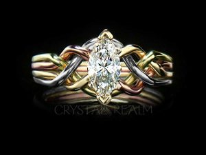 One-half carat marquise diamond engagement puzzle ring in four colors of 14K gold with open weave
