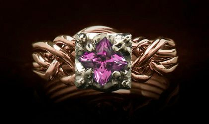 rose gold puzzle engagement ring with lab created pink sapphire
