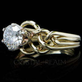 puzzle engagement ring with two carat round brilliant moissanite