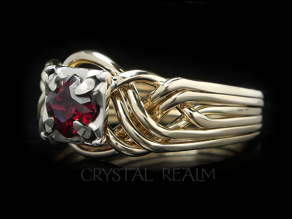 6 piece puzzle ring with cushion cut anthill garnet