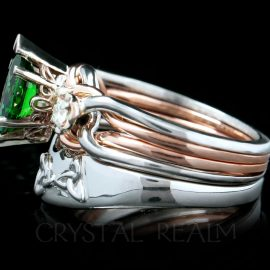 Palladium and 14K rose gold marquise tsavorite garnet and diamond engagement puzzle ring with palladium trinity knot shadow wedding band