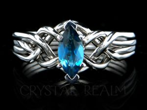 Marquise blue topaz engagement puzzle ring in platinum