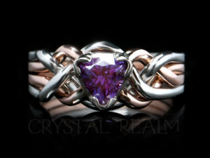 A trillion-cut, lab-created alexandrite graces a 14K rose gold and platinum puzzle ring.