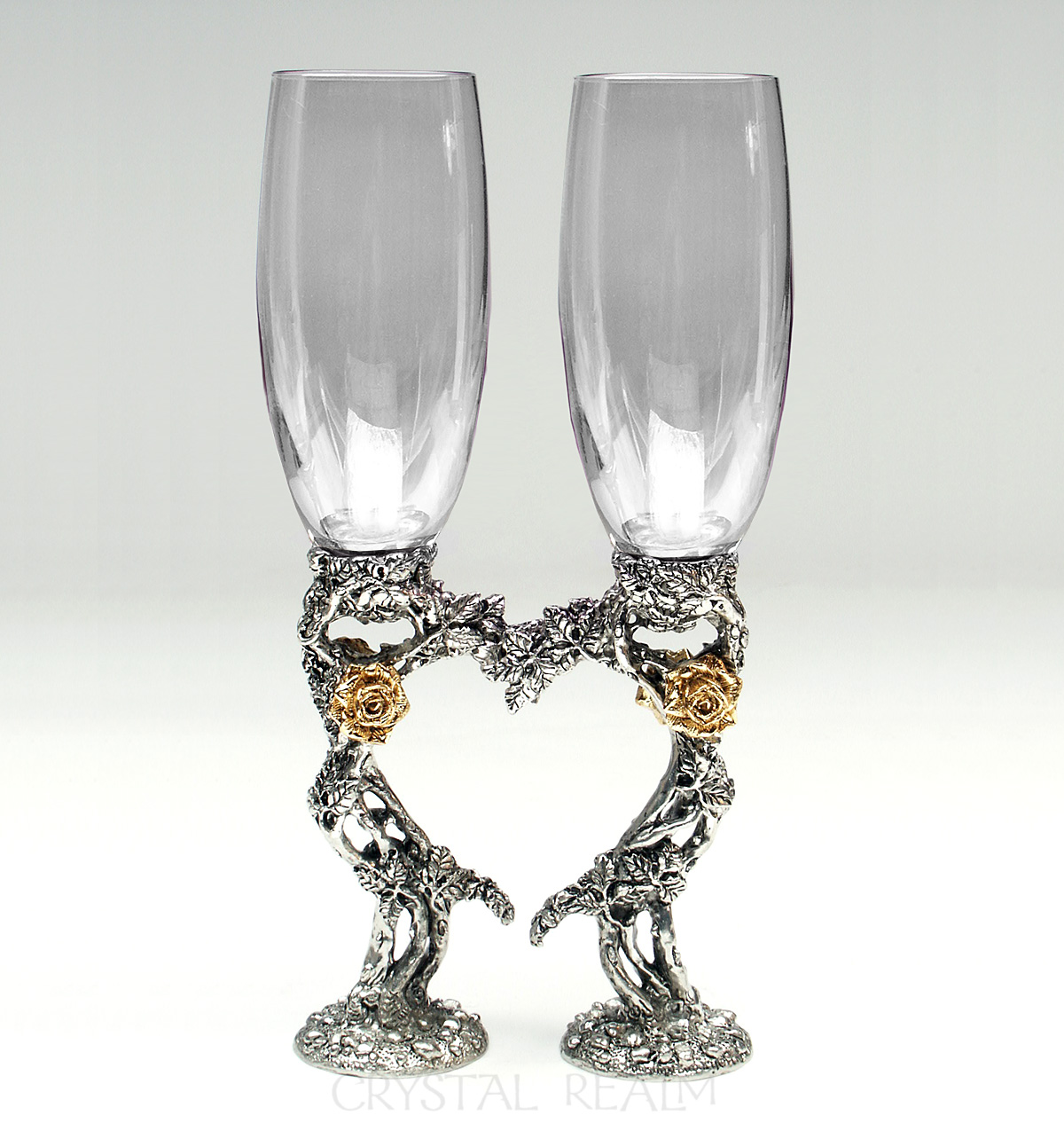 Clear champagne glasses with 23k plated roses and a heart shape