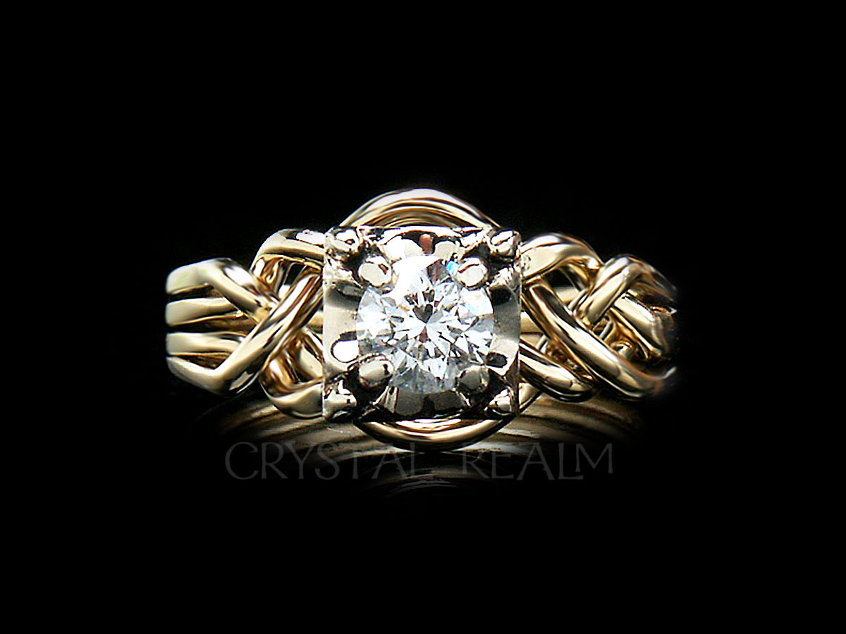 four band puzzle ring with round diamond and bands of 14k yellow gold with 14k white gold illusion setting