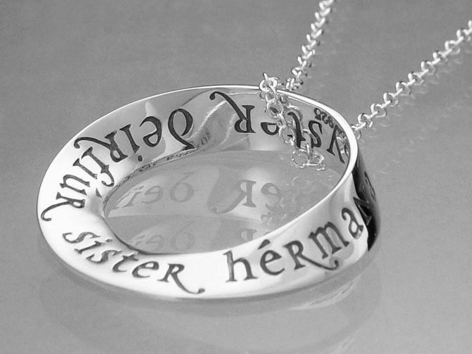 Sterling Silver Necklace: Sister in Eight Languages