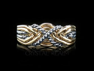 Six piece puzzle ring with twisted 'x' with four bands 14k yellow and twisted bands in palladium