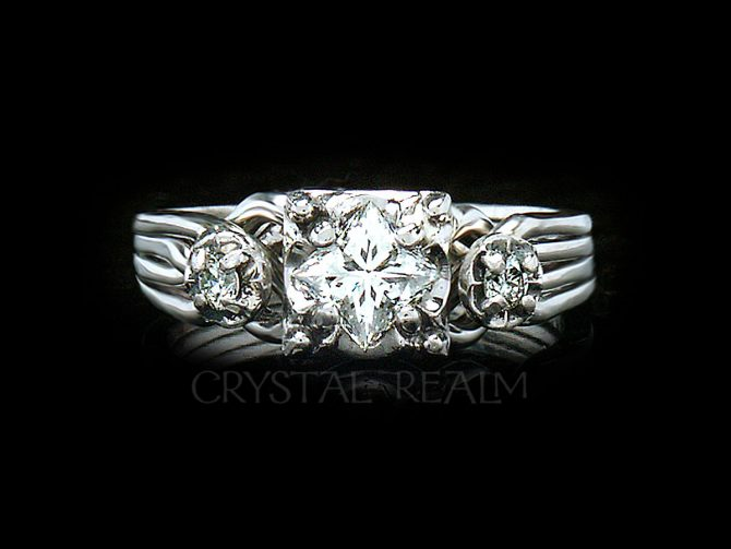 Four band puzzle ring with princess cut diamond center and two round accent diamonds