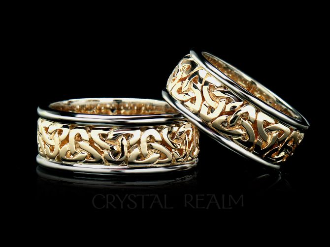 Celtic wedding band with yellow gold trinity knot center and white gold rims