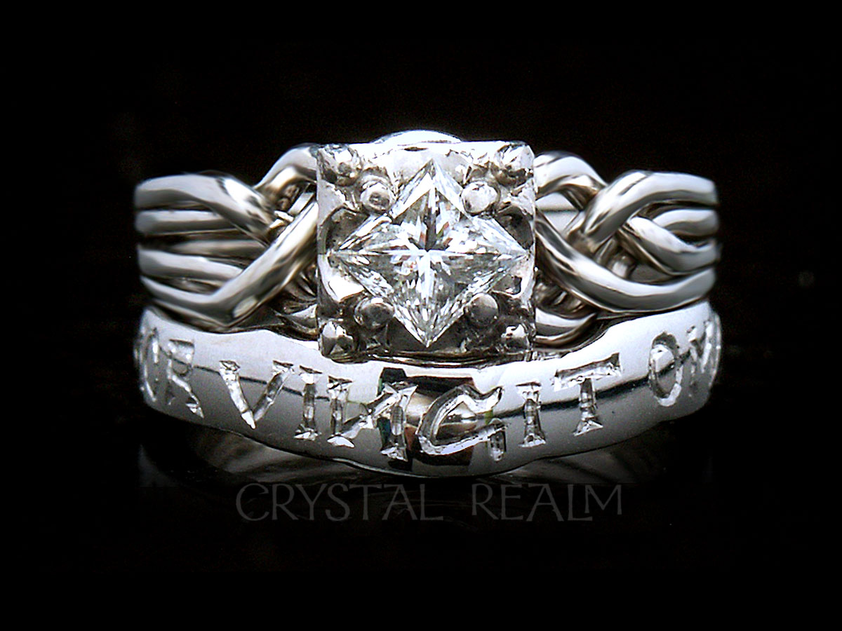 "Guinevere puzzle ring with custom ""amor vincit omnia"" shadow band"