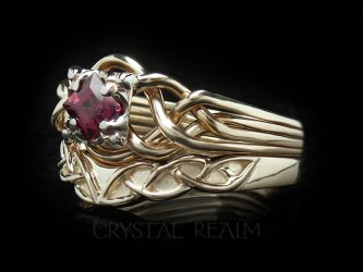 Rhodolite garnet in a princess-cut on a Guinevere four band puzzle ring with a Celtic wedding ring
